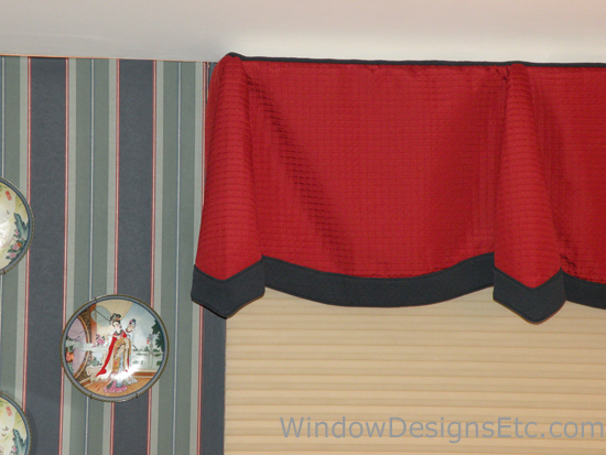 Red quilted scallop and cone valance with navy blue banding. Underneath is a Hunter Douglas Duette Architella honeycomb shade. Designed and Created by Window Designs Etc. By Marie Mouradian