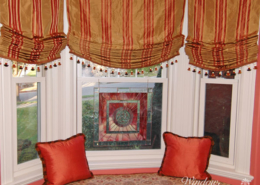 Roman shades are relaxed, hobbled, slatted or flat fold. Bay window seat with relaxed Roman shades Worcester, MA